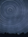 A Time-Exposure Creates Circular Star Tracks Around Polaris Photographic Print