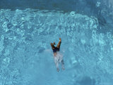 A Swimmer Dives into a Swimming Pool Photographic Print by Jodi Cobb