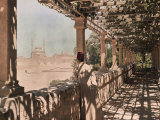 An Egyptian Man Looks out over the City from a Trellised Walkway Photographic Print
