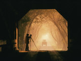 A Photographer Sets up His Camera in a Covered Bridge Photographic Print by Richard Nowitz