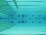 An Underwater Picture of an Indoor Swimming Pool Photographic Print by Sisse Brimberg