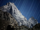Star Streaks Above a Rocky Ridge Photographic Print by Michael Nichols