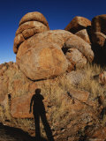 A Human Shadow is Projected onto One of the Devils Marbles Photographic Print by Nicole Duplaix