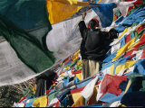 Lines of Prayer Flags are Placed on the Side of a Mountain Photographic Print by Maria Stenzel