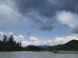 Cumulus Clouds Form over the Talkeetna River Photographic Print