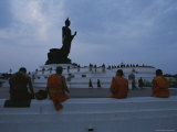 Buddhist Monks Meditate at a Statue of Buddha in Bangkok Photographic Print by Jodi Cobb