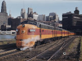 A Train on the Tracks with the Chicago Skyline in the Background Photographic Print