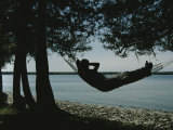 A Person Relaxes in a Hammock That Overlooks Lake Michigan Photographic Print by Stacy Gold