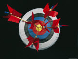 A Close View of Arrows Stuck in a Bulls Eye Photographic Print by Richard Nowitz