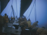 Seamen Tend to Their Sails During a Storm Photographic Print by Joe Scherschel