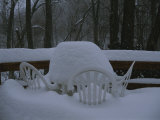 Several Feet of Snow Pile on Deck Furniture after a Heavy Snowfall Photographic Print by Stephen St. John