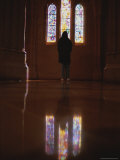 Polished Floor Reflects Visitor Admiring Stained Glass Windows Photographic Print by Stephen St. John
