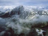 An Aerial View of Fog Shrouded Mountains Photographic Print