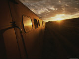 A View Down the Length of a Train on the ROVos Railway, at Twilight Photographic Print by Tino Soriano