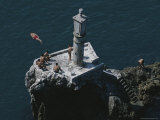Young Men Leap from a High Cliff into the Black Sea Below Photographic Print by Randy Olson