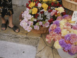 Colorful Flowers Fill Baskets at a Vendors Street-Side Stall Photographic Print by Tino Soriano