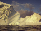 A Large Iceberg Obscures the Horizon Photographic Print by Bill Curtsinger