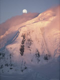 The Moon Rises over Snow- Blown Peaks on Anvers Island Photographic Print by Bill Curtsinger
