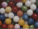 Close View of Colorful Gumballs in a Vending Machine Photographic Print by Stephen St. John
