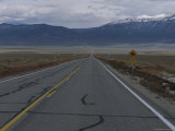 A Highway Points Toward the Distant Mountains Photographic Print by Stephen Alvarez
