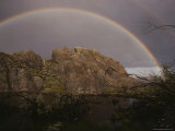 A Perfect Rainbow Arches over a Beaver Pond Protected by an Outcropping of Rock Photographic Print
