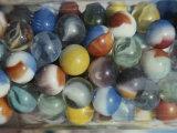 Close View of Colorful Glass Marbles in a Jar Fotografisk trykk av Stephen St. John