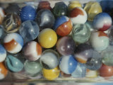 Close View of Colorful Glass Marbles in a Jar Photographic Print by Stephen St. John