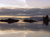 Islands and Clouds Reflect on a Calm Sea at Kah Shakes Cove Photographic Print by Bill Curtsinger