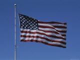 The American Flag Flies Proudly in a Stiff Breeze Fotografisk trykk av Stephen St. John