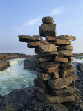 A Carefully Balanced Cairn Overlooking the Kerchoffer River Photographic Print by Norbert Rosing