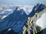 A Man on Mount Combatant, Coast Range, British Columbia Photographic Print by Jimmy Chin