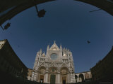 An Exterior View of the Siena Cathedral Photographic Print by Raul Touzon