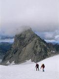 Mountain Climbers Hike Towards Cloud-Shrouded Bugaboo Spire Photographic Print