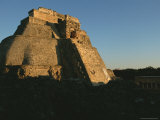 A Low Sunlit View of the House of the Magician Pyramid at Uxmal Photographic Print by Kenneth Garrett