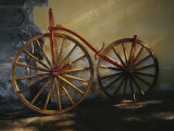 An Antique Bicycle Rests against a Wall Photographic Print by Raul Touzon