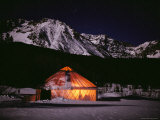 A Warm Glow Comes from the Dutchers Tent at Night Photographic Print by Jim And Jamie Dutcher