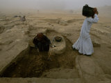 Workers Excavate Site of Ancient Pyramid Builders Production Center Photographic Print by Kenneth Garrett