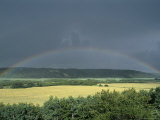 A Rainbow Spans the Sky Across a Farmers Field Photographic Print by Norbert Rosing