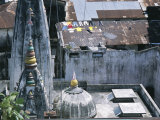 An Elevated View of Rooftops with Laundry, Spires, and Domes Photographic Print by Beverly Joubert
