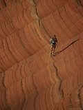 A Hiker Treks Across Sandstone Cross-Beds in Remote Pariah Canyon Photographic Print