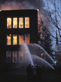 Firemen in Holland Shoot Water into a Burning House at Twilight Photographic Print