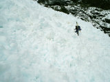 A Mountain Climber Crosses Through Avalanche Debris on Way to Camp Photographic Print by Gordon Wiltsie