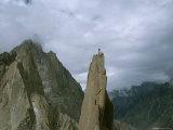 A Climber Stands Atop Tahir Tower, Karakoram Moutnains, Pakistan Photographic Print by Jimmy Chin