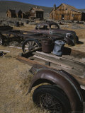 A View of Buildings and Old Vehicles at Bodie Ghost Town Photographic Print by Gordon Wiltsie