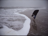 A Lone Figure Braves a Fierce Wind on a Wintry Chincoteague Beach Photographic Print by Medford Taylor