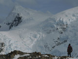 A Mountain Climber Stands Below the Highest Peak in the Range Photographic Print by Gordon Wiltsie