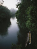 Two Long Canoes on a River Running Through the Costa Rican Rainforest Photographic Print by Tim Laman