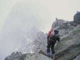 A Climber Ascends the Bugaboo Mountains During a Storm Photographic Print by Gordon Wiltsie