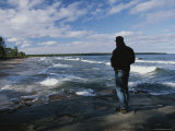 A Man Watches the Surf Pound the Beach Photographic Print