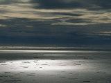 Sunlight Breaks Through Dark Clouds over Isabella Bay Photographic Print